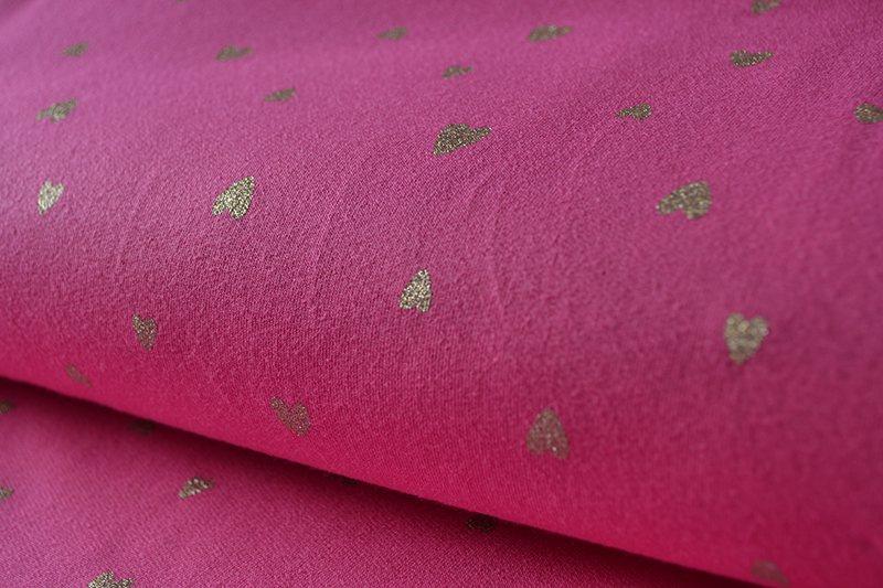 tessuto-jersey---cuoricini-d'oro-su-fucsia