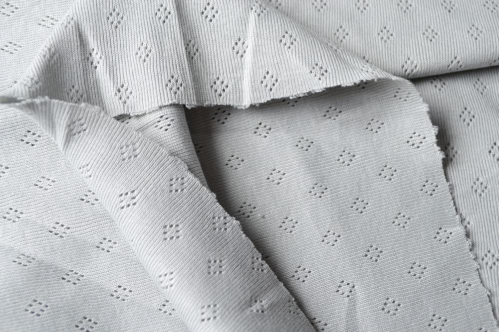 tessuto-a-maglia-pointoille-grigio-chiaro-
